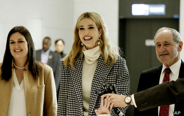 Flanked by White House Press Secretary Sarah Huckabee Sanders, left, Ivanka Trump, advisor to and daughter of U.S. President Donald Trump, speaks as she arrives at the Incheon International Airport in Incheon, South Korea, Feb. 23, 2018.