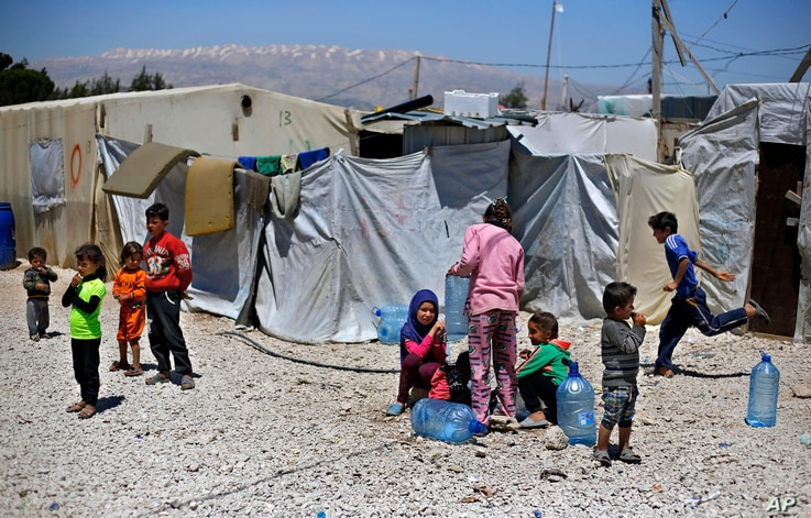 Syrian refugee children play outside their family tents at a Syrian refugee camp in the town of Bar Elias, in Lebanon's Bekaa Valley, April 23, 2018.