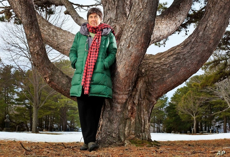 FILE - Roxanne Quimby, the founder of Burt's Bees, poses next to white pine in Portland, Maine, March 14, 2011.