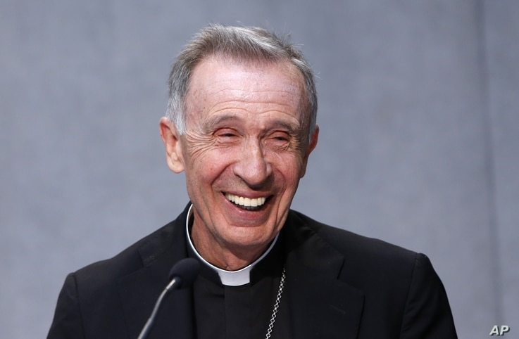 FILE - Monsignor Luis Francisco Ladaria Ferrer smiles during a news conference at the Vatican, Sept. 8, 2015. Pope Francis has tapped Ferrer to lead the powerful congregation that handles sex abuse cases and guarantees Catholic orthodoxy around the w...