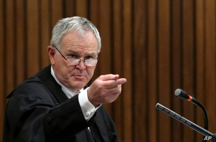 Defense lawyer Barry Roux gestures during the fourth day of sentencing proceedings in Pretoria, Oct. 16, 2014.