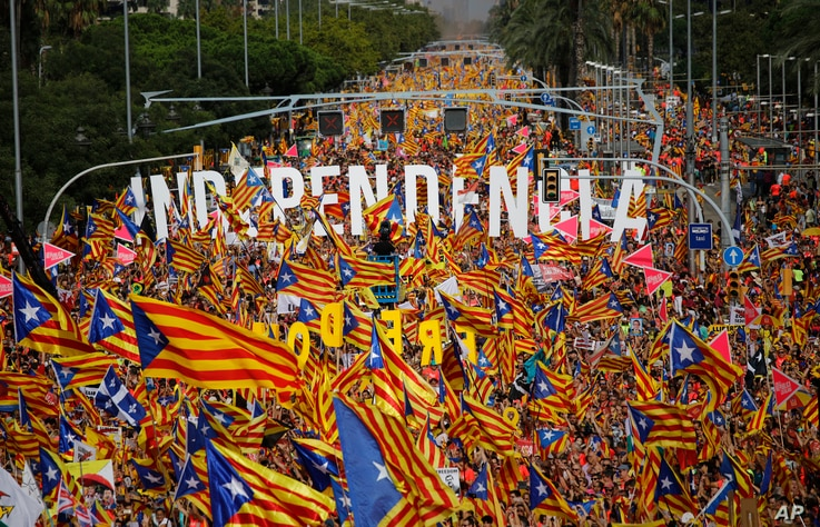 Pro-Independence demonstrators fill-up La Diagonal, one Barcelona's main avenues, during the Catalan National Day in Barcelona, Spain, Sept. 11, 2018.