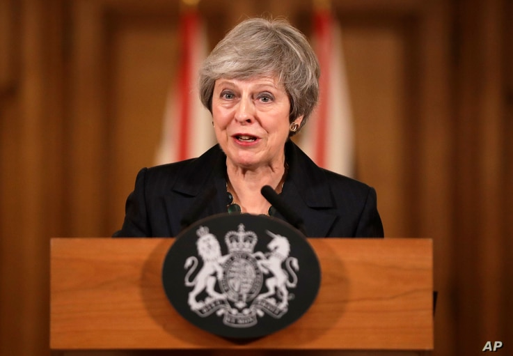 Britain's Prime Minister Theresa May speaks during a press conference inside 10 Downing Street in London, Thursday, Nov. 15, 2018.