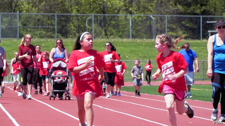 Students at Bermudian Springs school run on the track. The school is proud of its diversity, and staff members say they have worked successfully to integrate their minority students. (M. Kornely/VOA)