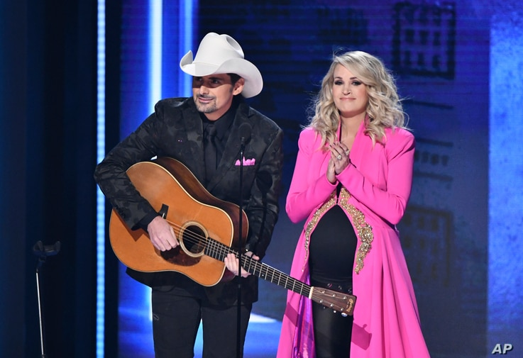 Hosts Brad Paisley, left, and Carrie Underwood appear at the 52nd annual CMA Awards at Bridgestone Arena, Nov. 14, 2018, in Nashville, Tenn.