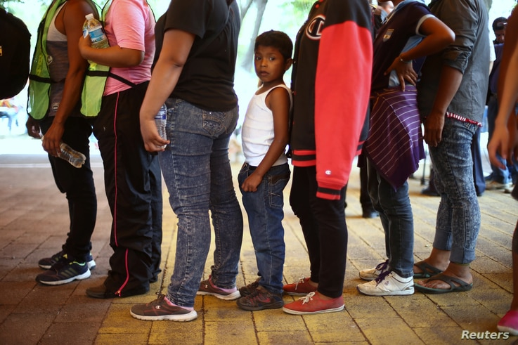 Central American migrants, moving in a caravan through Mexico toward the U.S. border, stand in line for food at a shelter set up for them by the Catholic church, in Puebla, Mexico April 6, 2018.