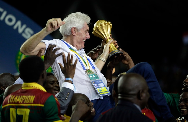 Cameroon coach Hugo Broos, from Belgium, is carried by the players after winning the African Cup of Nations final soccer match between Egypt and Cameroon at the Stade de l'Amitie, in Libreville, Gabon, Sunday, Feb. 5, 2017.