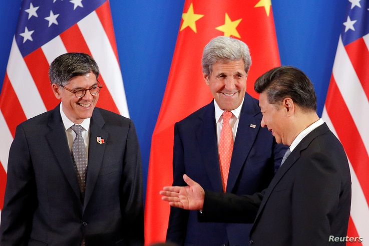 China's President Xi Jinping (R) meets with U.S. Secretary of State John Kerry and U.S. Treasury Secretary Jack Lew (L) during the joint opening ceremony of the 8th round of U.S.-China Strategic and Economic Dialogues and the 7th round of U.S.-China ...