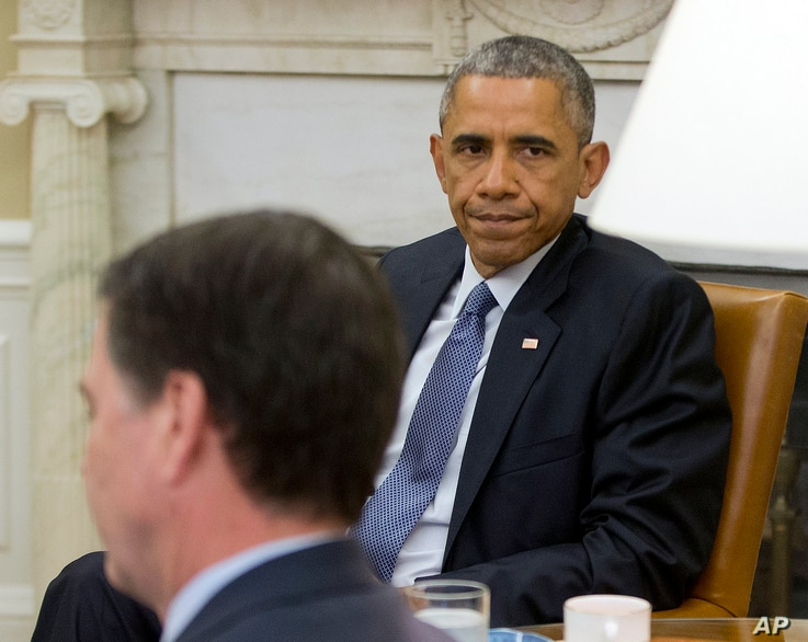 President Barack Obama, right, sits with FBI Director James Comey before speaking to members of the media about the shooting in Chattanooga, Tenn., from the Oval Office of the White House in Washington, July 16, 2015,
