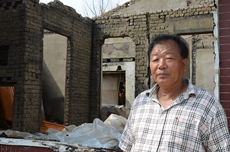 Community center president Kang Myung-sung hopes to obtain more central government support to turn the damaged structures into a tourism site. (Photo: VOA/Steve Herman)