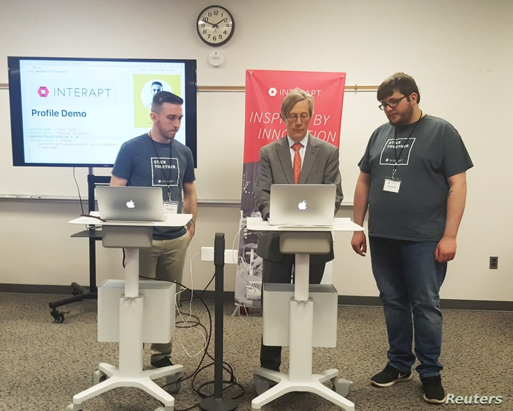 Co-director of the Appalachian Regional Commission Earl Gohl, center,, is participating in a coding demo with Interapt trainees in Paintsville, Kentucky, March 13, 2017.