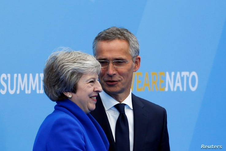 Britain's Prime Minister Theresa May is welcomed by NATO Secretary-General Jens Stoltenberg at the start of a NATO summit at the Alliance's headquarters in Brussels, Belgium