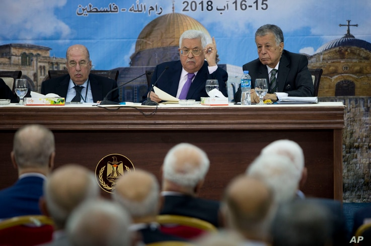 FILE - Palestinian President Mahmoud Abbas, center, speaks during a meeting with top decision-making body the Palestinian Central Council, at his headquarters in the West Bank city of Ramallah, Aug. 15, 2018.