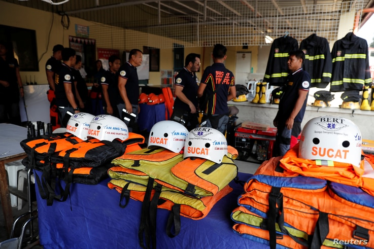 Rescuers ready their gear before Super Typhoon Mangkhut hits the main island of Luzon, in Muntinlupa, Metro Manila, Philippines, Sept. 13, 2018.