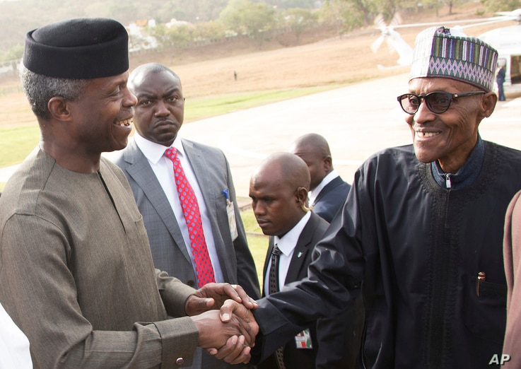 FILE - Nigeria President Muhammadu Buhari (right) is welcomed by Nigeria Vice President Yemi Osinbajo (left) upon arrival from his medical vacation in Abuja, Nigeria, March 10, 2017.
