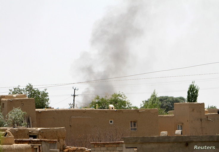 Smoke rises from a residential area where gun battle is going on between Taliban and Afghan forces in Ghazni province, Afghanistan Aug. 10, 2018.