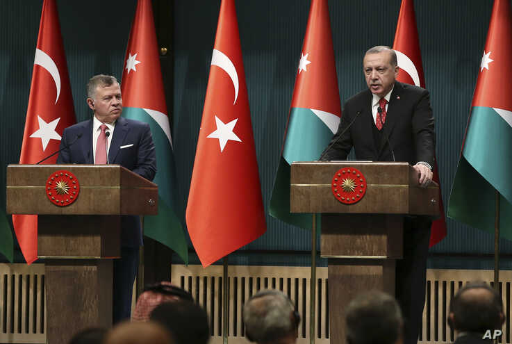 Turkey's President Recep Tayyip Erdogan, right, talks during a joint news conference with Jordan's King Abdullah II, left, following their meeting at the Presidential Palace in Ankara, Turkey, Dec. 6, 2017.