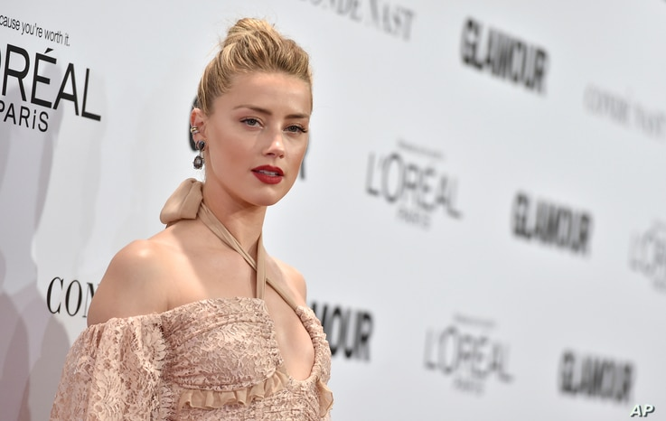 FILE - Amber Heard arrives at the Glamour Women of the Year Awards at NeueHouse Hollywood, Nov. 14, 2016, in Los Angeles.
