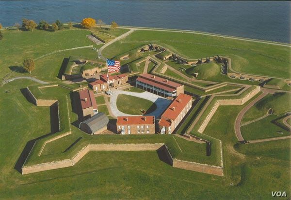 An aerial view of Fort McHenry. The 15-star flag shown is current, but it approximates the oversized flag that flew over the fort during the fateful bombardment of 1814. (National Park Service)