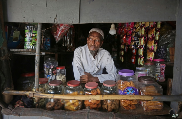 A Rohingya refugee Abdul Rahim, who runs a small grocery shop, waits for customers at a camp for the refugees in New Delhi, India, Aug. 16, 2017.