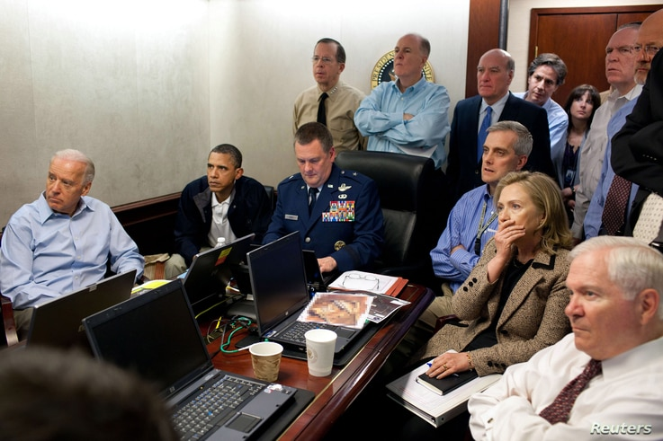 U.S. President Barack Obama (2nd L) and Vice President Joe Biden (L), along with members of the national security team, receive an update on the mission against Osama bin Laden in the Situation Room of the White House, May 1, 2011.