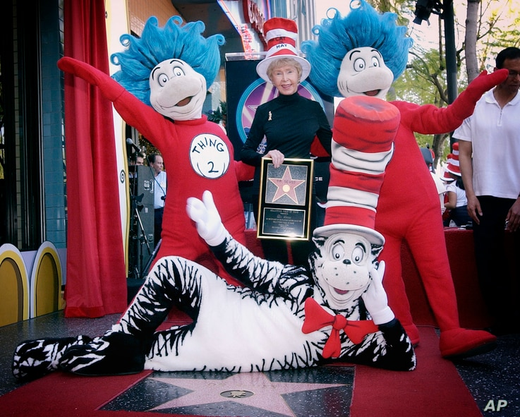FILE - Audrey Geisel, widow of author Theodor Seuss Geisel, poses with The Cat in the Hat, foreground, and Thing 1 and Thing 2, who are characters from his books, at the dedication of Dr. Seuss' posthumous star on the Hollywood Walk of Fame in Los An...