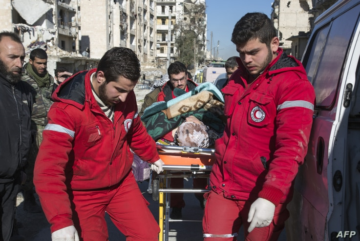 Staff of the Syrian Red Crescent pulls a stretcher with a wounded person during an evacuation operation of rebel fighters and their families from rebel-held neighbourhoods in the embattled city of Aleppo on Dec. 15, 2016.