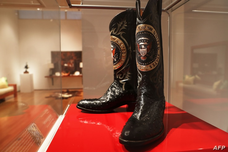A pair of Ronald Reagan's cowboy boots sit in a case at Christie's where items from the former president and Nancy Reagan's California home are to be auctioned Sept. 16, 2016, in New York City.