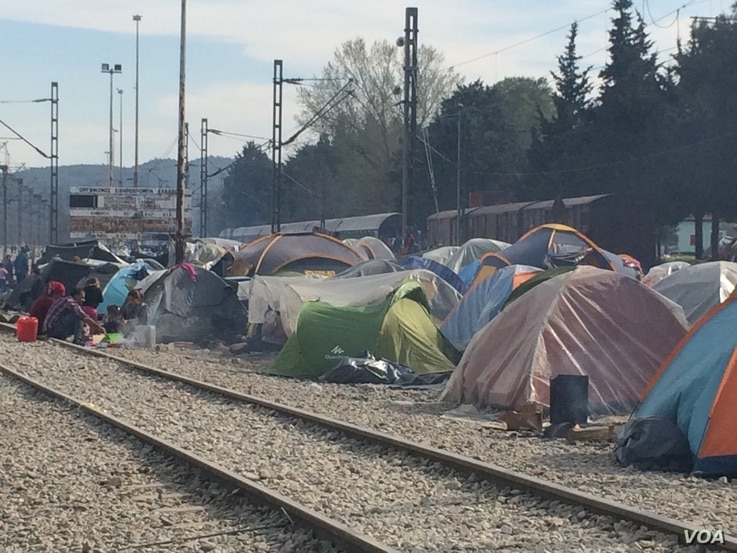 Besides staging sit-ins on the tracks, refugees set up tents to prevent trains from moving, in Idomeni, Greece, March 30, 2016. With no money or any political influence, refugees say it's the only leverage they have. (Photo - H. Murdock/VOA)