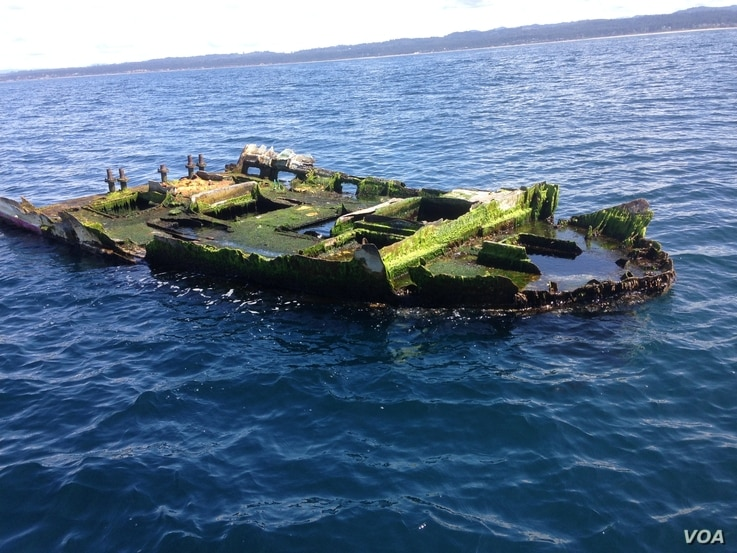 This is the Japanese boat wreckage that was recovered off of Newport, Oregon last April with a school of non-native fish inside its hull. (Photo courtesy of John Chapman, OSU-HMSC)