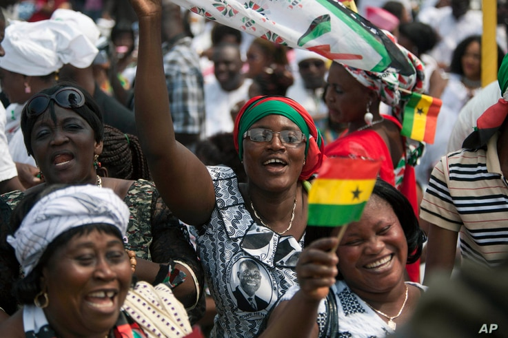 Supporters cheer during the inauguration ceremony for President John Mahama in Accra, Ghana, Jan. 7, 2013. The election for Ghana's next president will be held December 7.