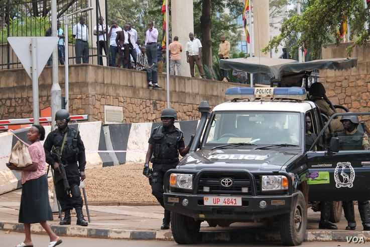 Anti-terrorism police stand guard outside the parliament building in Kampala, Uganda, Sept. 21, 2017, as legislators meet to consider an amendment to the Constitution to lift the presidential age limit.