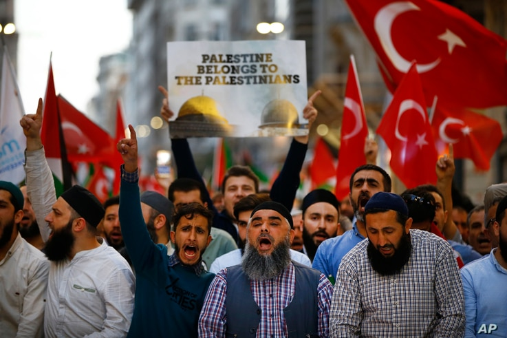 Protesters, some holding Turkish flags, chant slogans during a demonstration in Istanbul against the move of the U.S. embassy from Tel Aviv to Jerusalem, May 14, 2018.