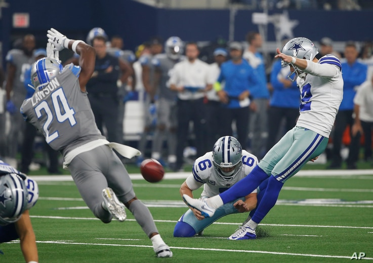 FILE - Dallas Cowboys kicker Brett Maher (2) kicks a field goal as punter Chris Jones (6) holds and Detroit Lions defensive back Nevin Lawson (24) defends in the first half of an NFL football game in Arlington, Texas, Sept. 30, 2018.