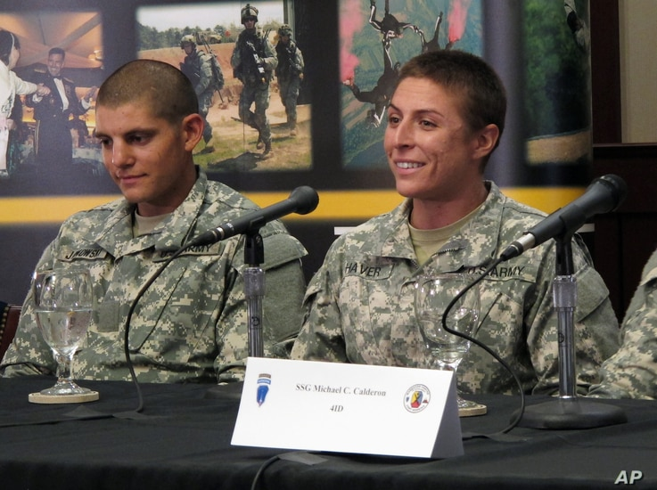 U.S. Army Army 1st Lt. Shaye Haver, right,  speaks with reporters, Thursday, Aug. 20, 2015.