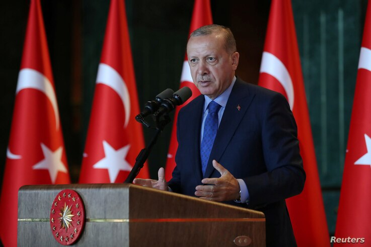 Turkey's President Tayyip Erdogan addresses Turkish Ambassadors during a meeting in Ankara, Turkey, Aug. 13, 2018.
