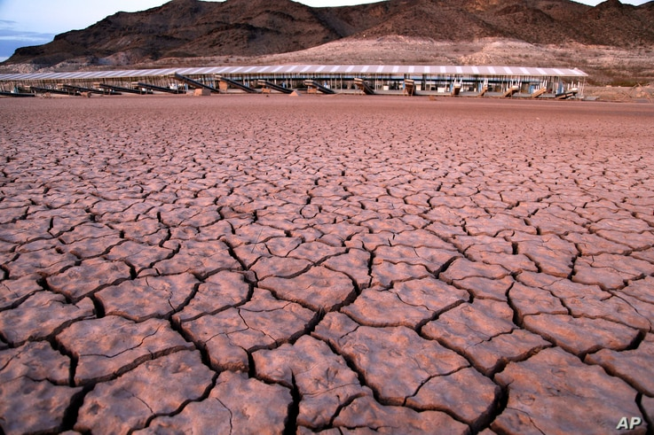 FILE - What was once a marina sits high and dry because of the receding water in the Lake Mead National Recreation Area in Arizona, July 16, 2014.