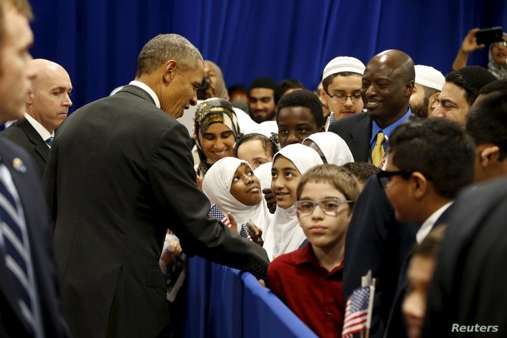 U.S. President Barack Obama greets students after his remarks at the Islamic Society of Baltimore mosque in Catonsville, Maryland, Feb. 3, 2016.