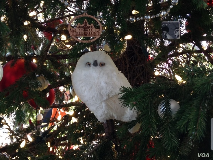 This snowy owl is one of many animals that decorate the giant Douglas fir tree at the US Botanic Garden's holiday display.