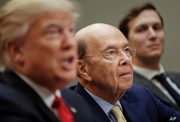 Commerce Secretary Wilbur Ross, center, listens to President Donald Trump during a meeting with House and Senate legislators in the Roosevelt Room of the White House, Feb. 2, 2017.