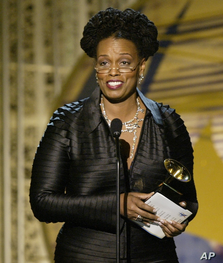 "Dianne Reeves accepts her award for best jazz vocal album for ""A Little Moonlight"" during the 46th Annual Grammy Awards, Sunday, Feb. 8, 2004, in Los Angeles."