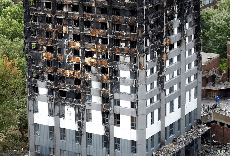 The burnt Grenfell Tower apartment building standing testament to the recent fire in London, June 23, 2017.