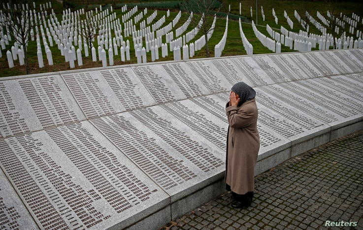 Bida Smajlovic, prays near the Memorial plaque with names of killed in Srebrenica massacre before watching the Trial in Hague Tribunal, in Potocari near Srebrenica, Bosnia and Herzegovina March 24, 2016.