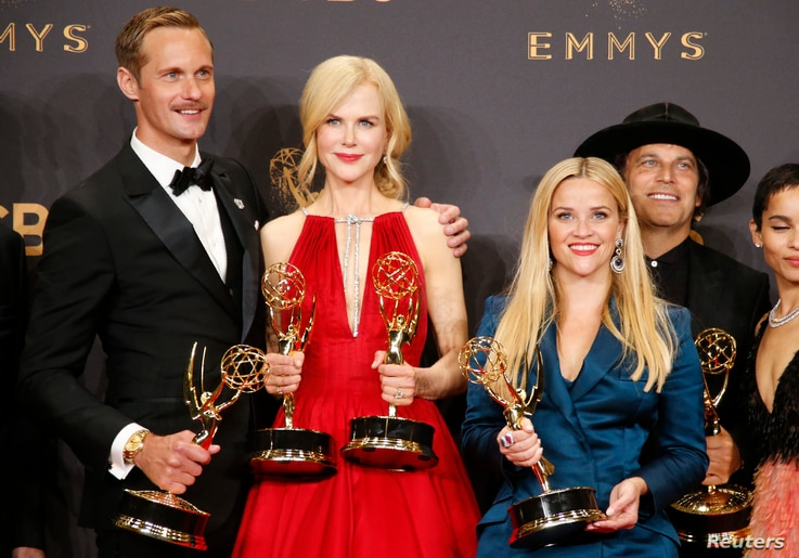 "Alexander Skarsgard, Nicole Kidman, Reese Witherspoon and others pose with their Emmy for Outstanding Limited Series for ""Big Little Lies"" at the 69th Primetime Emmy Awards, Los Angeles, California, Sept. 17, 2017."