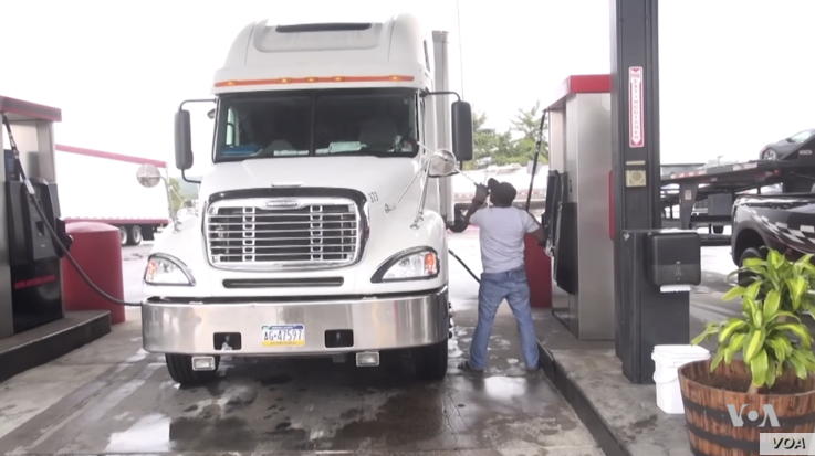 Elias Balima, an immigrant from Burkina Faso, fuels up the truck he spent years saving to buy and now rarely finds himself without work.