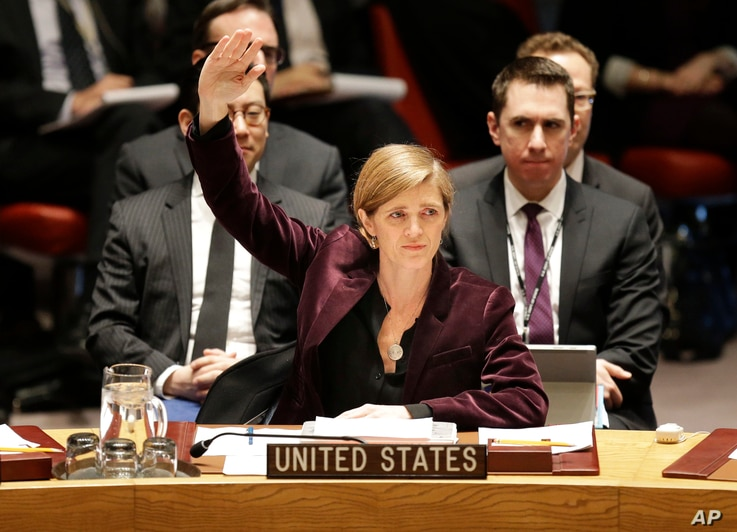 FILE - U.S. Ambassador to the United Nations Samantha Power votes on a resolution during a Security Council meeting at U.N. headquarters in New York, March 2, 2016.