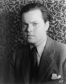 The brilliant actor and director Orson Welles at age 22 in 1937, a year before he and his acting troupe scared the daylights out of thousands of radio listeners on Halloween eve.