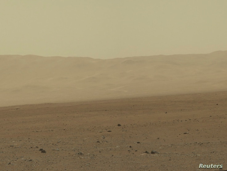 FILE -  This color image taken August 8, 2012 from NASA's Curiosity rover, and released August 13, shows part of the wall of Gale Crater, the location on Mars where the rover landed on August 5, 2012.