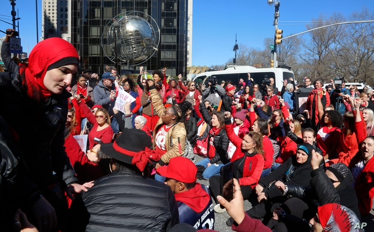Demonstrators at the International Women's Day rally stage a sit-down protest outside Trump International Hotel at Columbus Circle, March 8, 2017, in New York.
