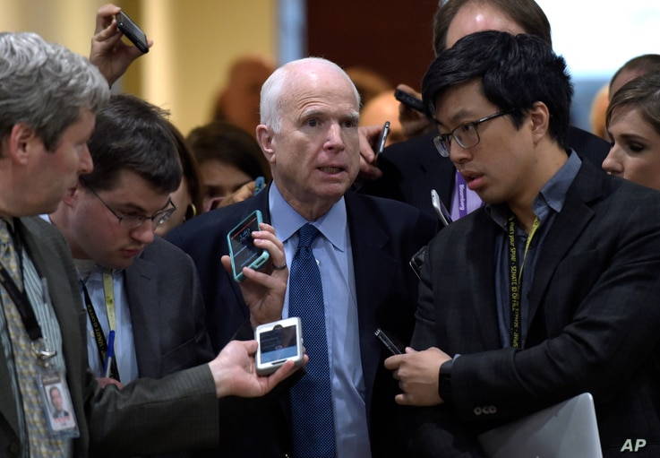 Sen. John McCain, R-Ariz., center, speaks to reporters following a briefing on Syria on Capitol Hill in Washington, April 7, 2017.